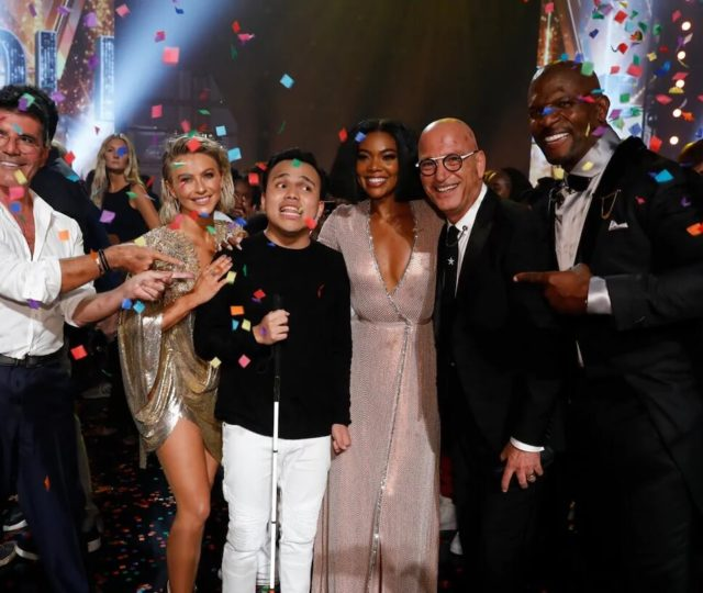 AGT winner Kodi Lee poses with judges Simon Cowell, Julianne Hough, Gabrielle Union, and Howie Mandel.