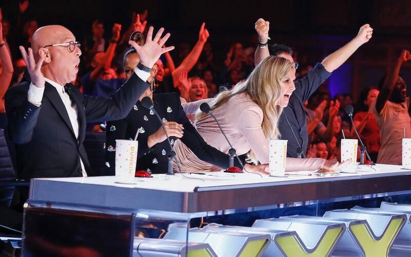 "Heidi Klum hitting the Golden Buzzer on ""AGT: The Champions"""